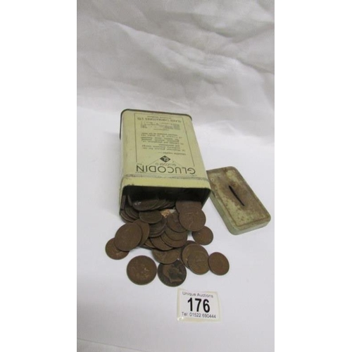 176 - A tin of early 20th century copper pennies and half pennies etc...