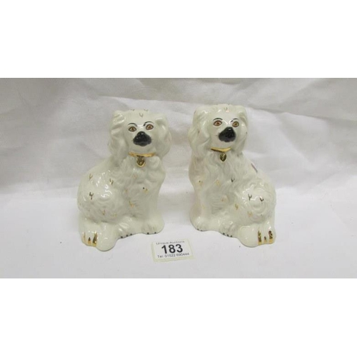 183 - A pair of small Staffordshire spaniels...