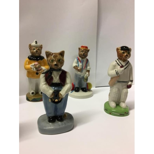 194 - 8 Wade Catkins figurines, UK1 ceramics...
