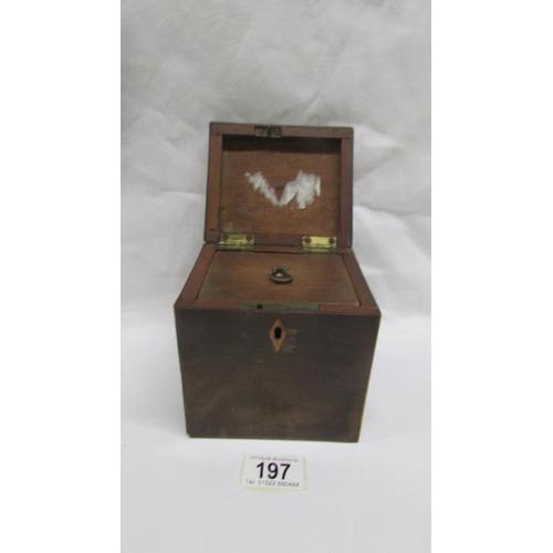 197 - An early 19th century mahogany tea caddy...