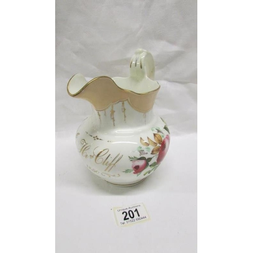 201 - A mid 19th century lustre jug...