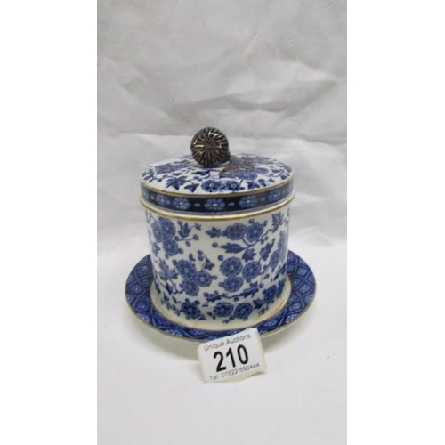 210 - A 19th century Ridgways blue and white lidded jar with lozenge mark, a/f...