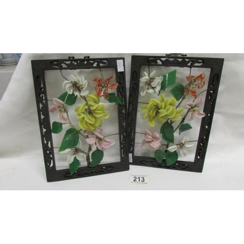 213 - A pair of Oriental floral panels...