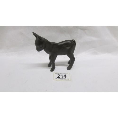 214 - A bronze lamb signed F.K....