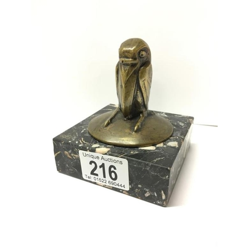 216 - An unusual bronze of a bird on a marble base, 11cm high including base...