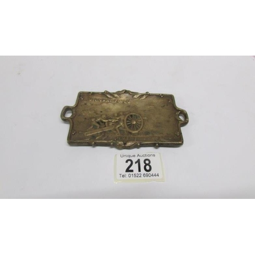 218 - A bronze first world war dish (11cm long) marked 'Un Vrat poilu Notre 75 En Action'...