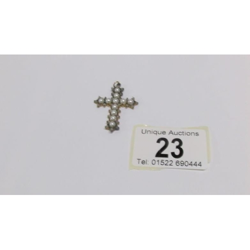 23 - A diamond and pearl cross...