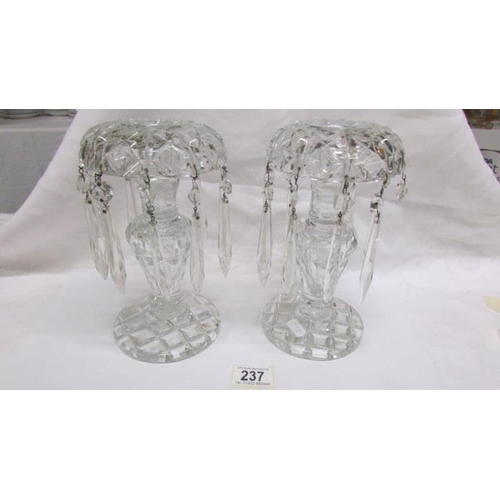 237 - A pair of heavy cut glass lustre candlesticks...