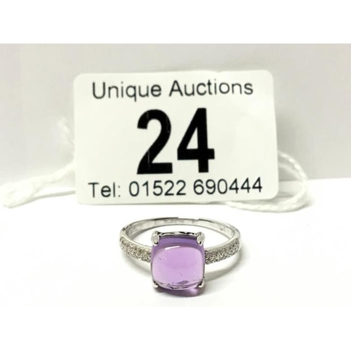 24 - An 18ct white gold amethyst and diamond ring, size 0...