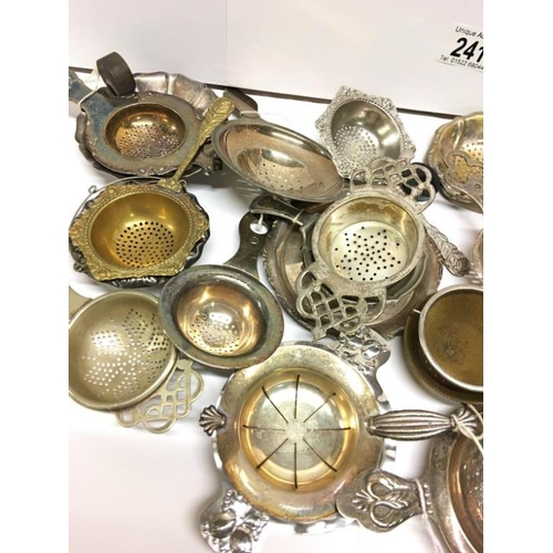 241 - A collection of 25 mainly silver plate tea strainers...