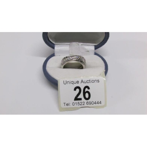 26 - An 18ct white gold diamond and sapphire ring, size P...
