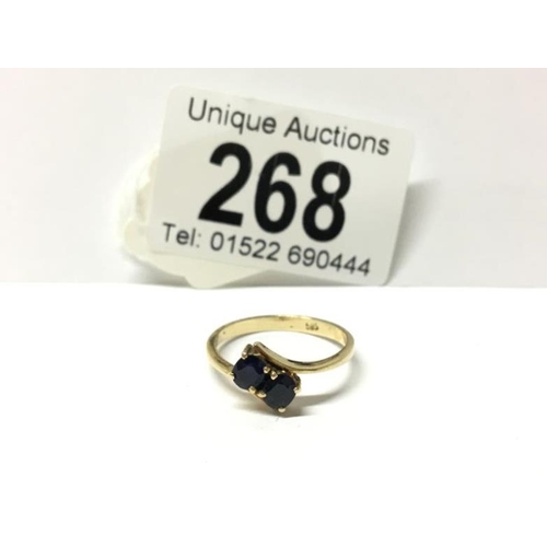 268 - A 14ct gold 2 stone sapphire ring...
