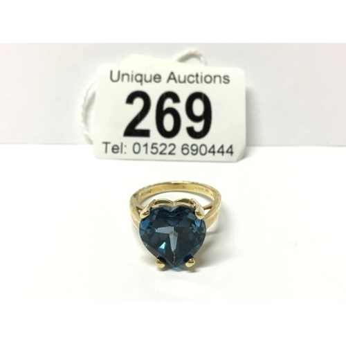 269 - A 9ct large heart shaped topaz ring...