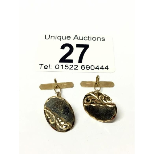 27 - A pair of 9ct gold cuff links...