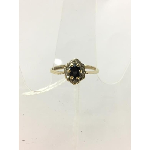 271 - A 9ct yellow gold sapphire and diamond ring...