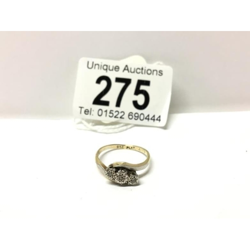 275 - A yellow gold 3 stone diamond cross over ring...