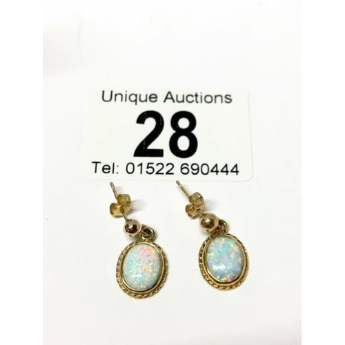 28 - A pair of yellow gold opal earrings...