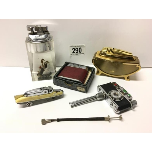 290 - 5 lighters including KKW camera lighter, rare Sarome Bluebird (front wheels missing) and a lucite li...
