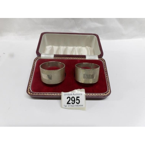 295 - A cased pair of heavy silver napkin rings, 91g....