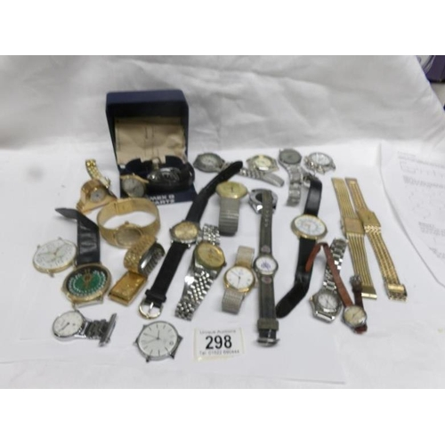 298 - A large mixed lot of watches including 1981 Timex Quartz in full working order and with service hist...