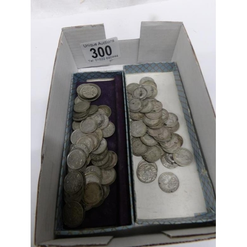 300 - A quantity of pre 1947 silver threepenny bits (3.3oz/94g) and a quantity of pre 1920 silver threepen...