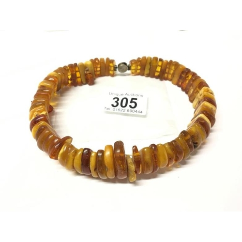 305 - An amber necklace...