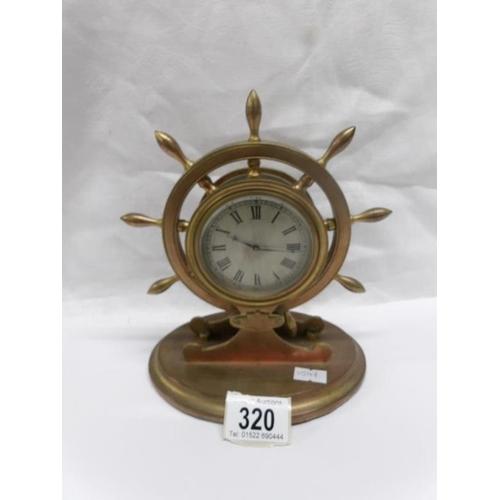 320 - A ships wheel clock...