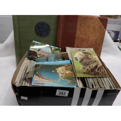 343 - 2 old postcard albums (empty) and a box of postcards...