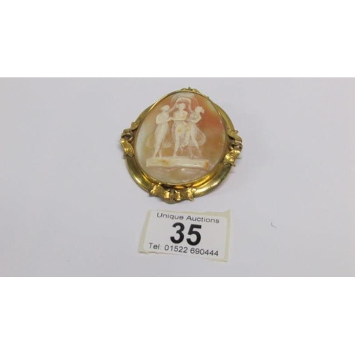 35 - A three graces cameo brooch set in yellow metal...