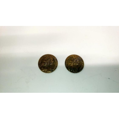 352 - 2 early coins and a pair of coin cuff links...