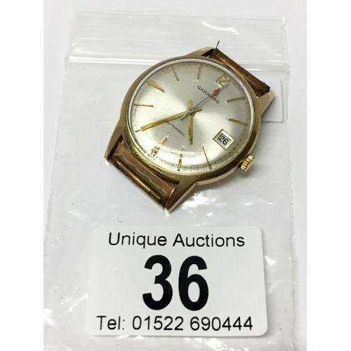 36 - A Garrard watch with 9ct gold back...