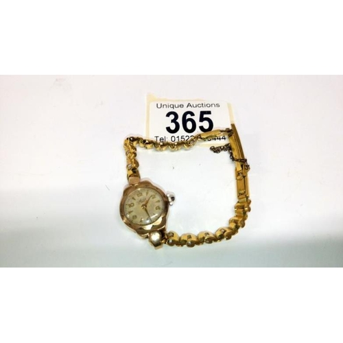 365 - An Avia ladies 9ct gold cased wrist watch with plated strap...