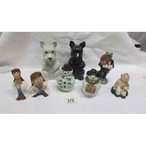370 - 8 Wade figurines including Tetley Tea Folk salt and pepper, Snowman salt and pepper, Baby, Travellin...