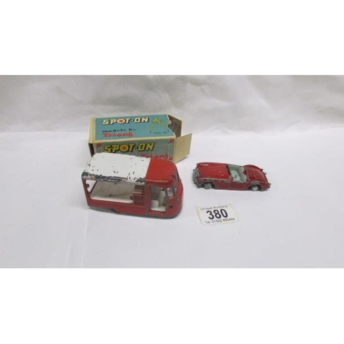 380 - A boxed Spot-on United Daires milk float and an unboxed MGA, both playworn...