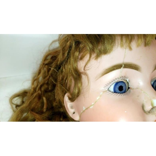 392 - A Victorian bisque head doll with glass eyes, a/f...