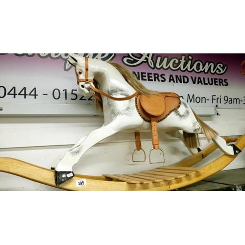 395 - A vintage rocking horse...