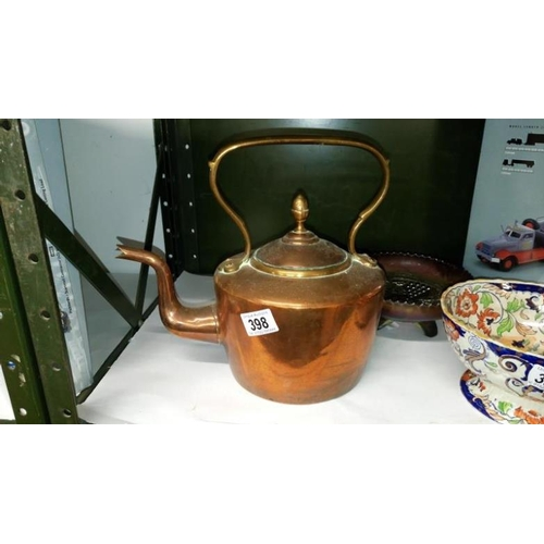 398 - A 19th century copper kettle...