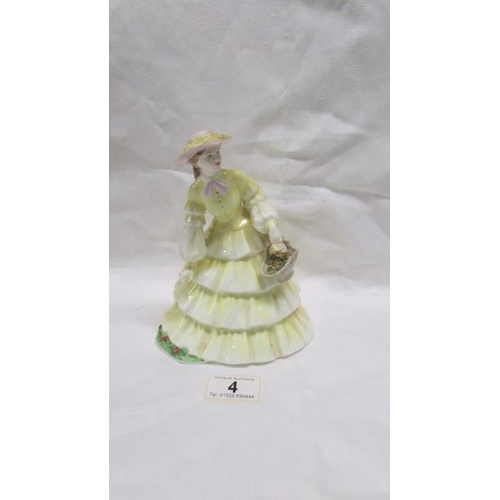 4 - A Coalport figurine 'Strawberry Fair'...