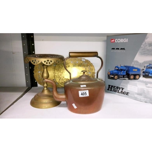 405 - A brass trivet, 2 brass plaques and a copper kettle...