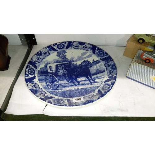 409 - A large Delft charger...