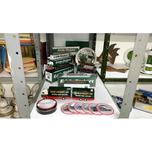 415 - A quantity of Eddie Stobart collectables including Atlas model lorries, DVD's etc...