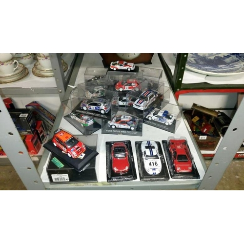 416 - 17 boxed touring rally cars...