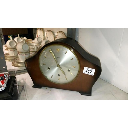 417 - An old mantel clock...