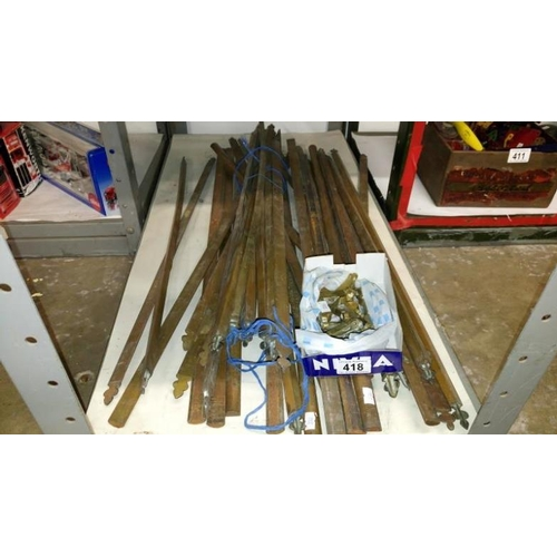 418 - A quantity of brass stair rods and fittings...