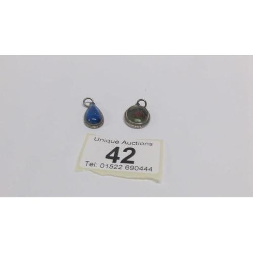 42 - 2 silver pendants...