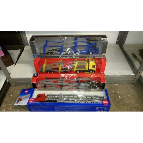 425 - 4 boxed 1.43 scale Newray car transporters and a 1.50 scale Siku transporter...