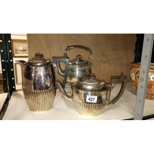 427 - A silver plated spirit kettle on stand and 2 tea pots...