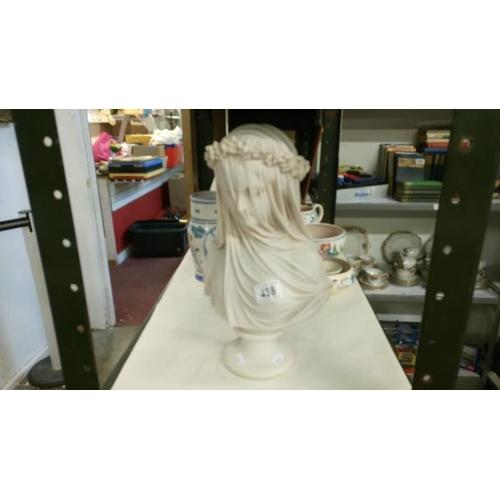 438 - A bust of a veiled lady...