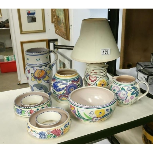 439 - A mixed lot of Poole pottery including table lamp...