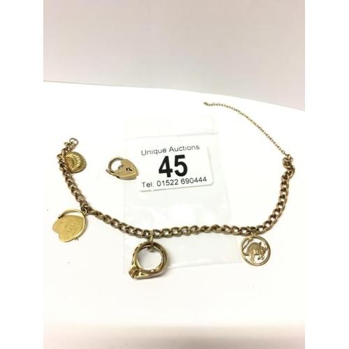 45 - A gold charm bracelet (10 gms)...
